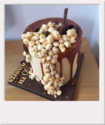 Drip cake with pop corn made by All Things Cake Epsom