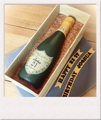 champagne bottle cake entirely edible made by All Things Cake Epsom